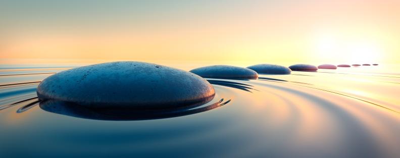 Zen-Steine im Wasser - sichere Entwicklung durch Geistige Aufrichtung in Bonn